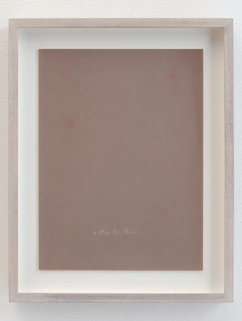 <i>Untitled (Skin too thin, agfa skin lightened through time, embossed middle)</i><br>Imprint of handwriting on photographic paper<br>12 1/4 x 9 3/4 inches<br>2012