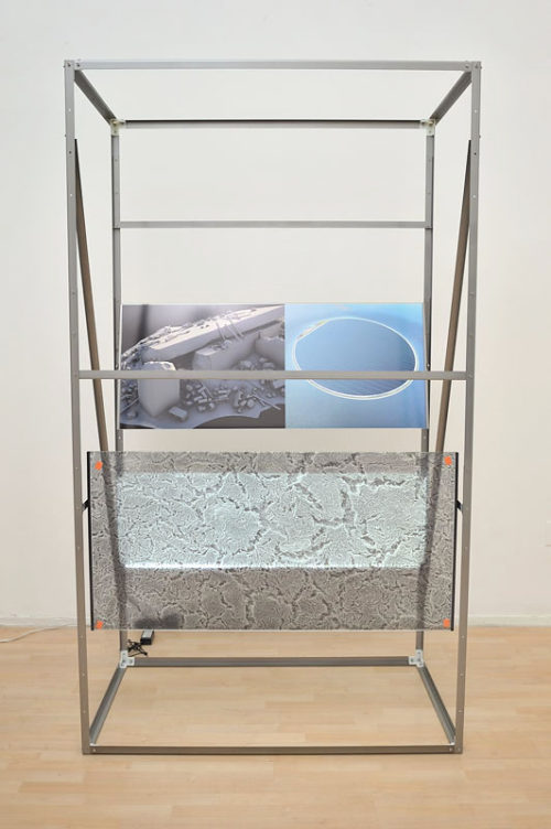 Hannah Sawtell<br>Terminal Vendor (Offshore Mix)<br>Cut out bent lacquered steel, window decal, fixings, tuffened glass, Perspex<br>86 1/2 x 27 1/2 x 47 1/4 inches<br>2013
