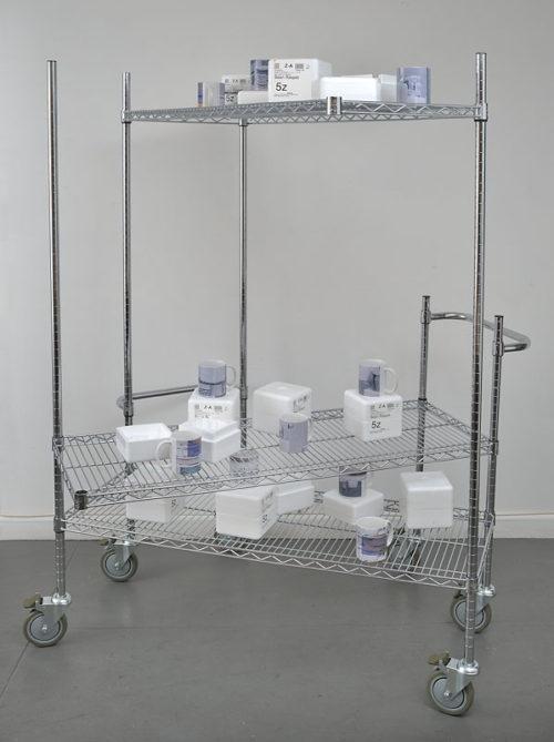 "Sean Raspet<br>2Registration::(""Untz'tled (Police Incident (7[a])) 6, (((2007-2012) 2007-2011."") "") 2012) 2012-2013<br>Steel shelving unit, digitally printed mugs, styrofoam<br>69 x 49 x 49 inches<br>2013"