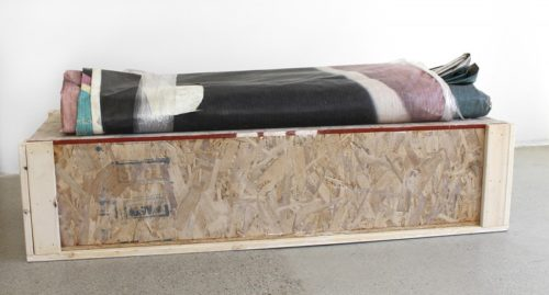 Hugh Scott-Douglas<br><i>Untitled</i><br>Folded billboard, wooden shipping crate<br>49.5 x 17 x 11.5 inches<br>2014