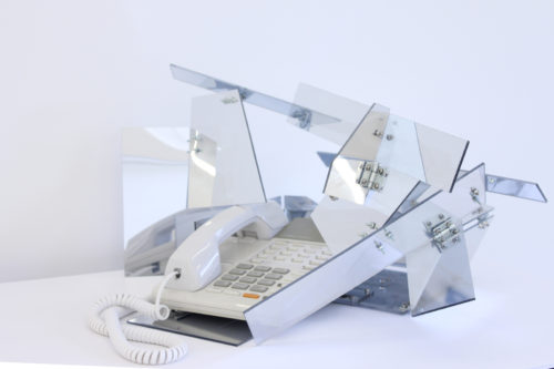 Sean Raspet<br><i>Inflection</i><br>2 way mirrored Plexiglas,  stainless steel fasteners, telephone<br>Dimensions variable<br>2010