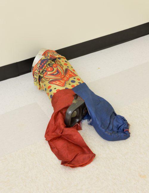 <i>Untitled (clown)</i>, 2016 <br> Modified vacuum, children's costume <br> 12 x 14 x 30 inches / 30.5 x 35.6 x 76.2 cm
