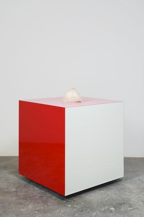 Nevine Mahmoud<br><i> Tutti Laying</i>, 2016<br> Alabaster, laminate cube<br> Sculpture: 8 x 5 inches / 20.3 x 12.7 cm<br> Pedestal: 28 x 28 x 28 inches / 71.1 x 71.1 x 71.1 cm