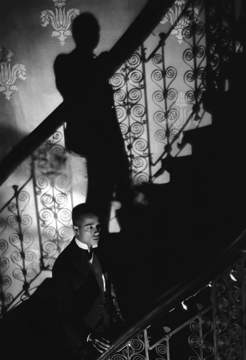Isaac Julien  <br/><i>Film-Noir Staircase (Looking for Langston Vintage Series) </i><br/ >Edition 1 and 2 of 4 + 2AP<br/ >Ilford classic silver gelatin fine art paper, mounted on aluminum and framed <br /> 22 7/8 x 29 3/8 in inches<br /> 1989/2016