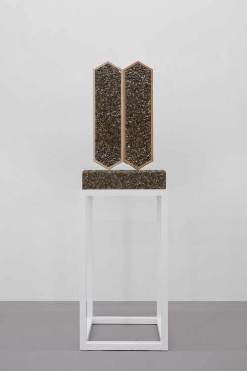Julian Hoeber <br/><i>A Model of the Emotional Life of a Bag of Concrete</i><br/>Pea gravel, epoxy, polyester, nylon mesh, plywood, polyester resin<br/>Approximate dimensions 66 x 20 x 18 inches<br/> 2017