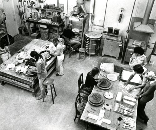 Judy Chicago in the studio with others, preparing for <i>The Dinner Party</i>, 1979