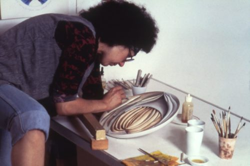 Judy Chicago working on <i>Hrosvitha Test plate #3</i>, 1975-1978