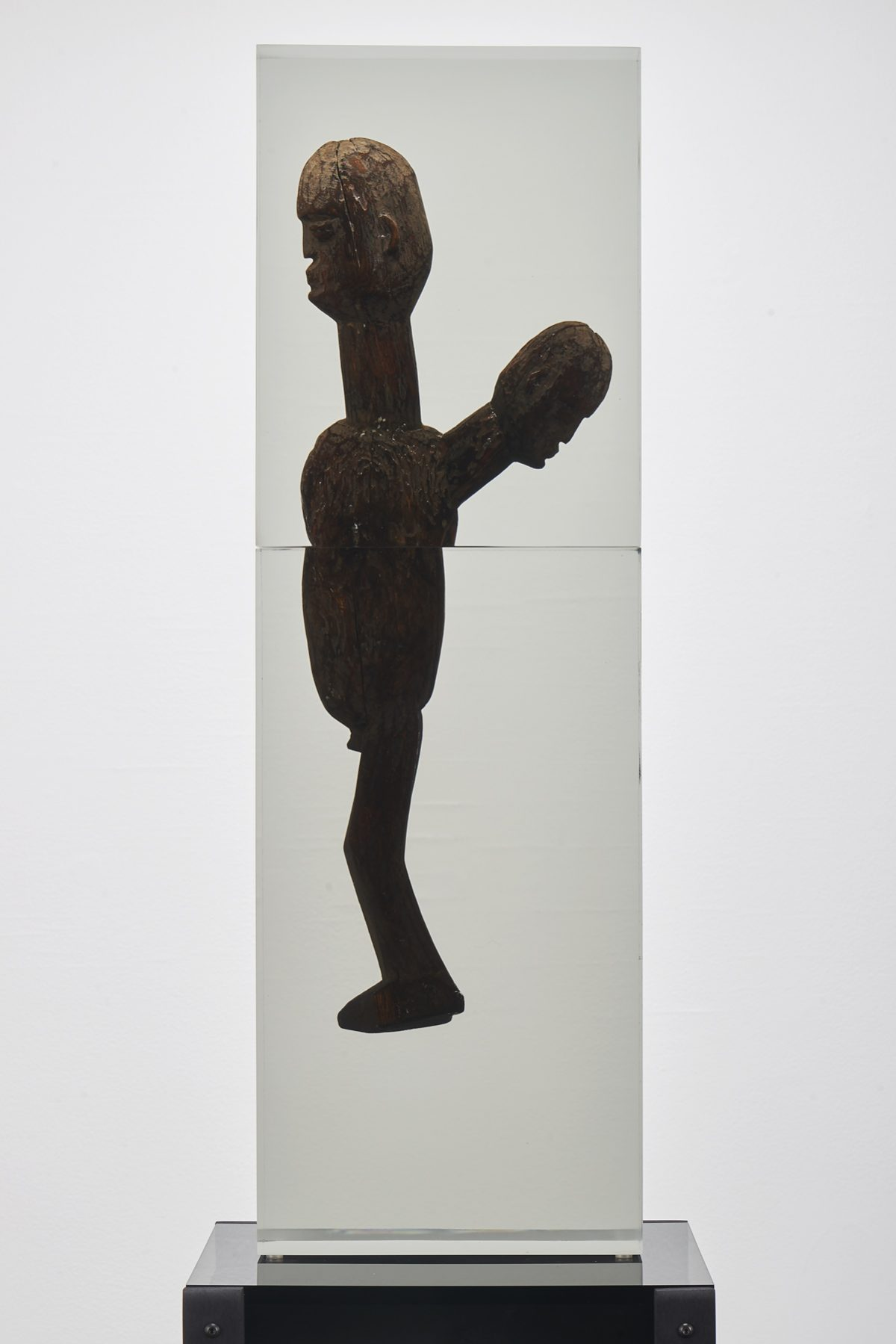 <i>Dark Silhouette: Enduring Father</i><br> Wooden sculpture from West Africa, polyurethane resin, anodized aluminum, acrylic<br> Sculpture: 31 x 9 3/4 x 4 inches / 78.7 x 24.9 x 10.2 cm<br> Overall: 67 x 13 x 13 inches / 170.2 x 33 x 33 cm<br> 2018
