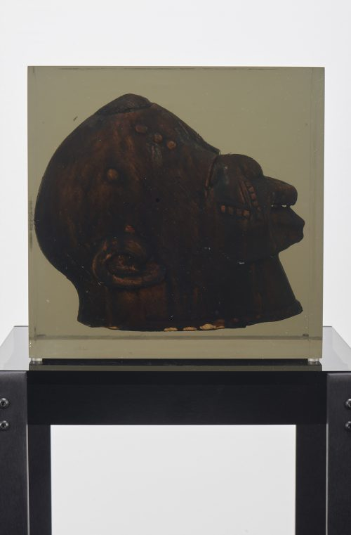 <i>Dark Silhouette: Forward Gaze</i><br> Wooden sculpture from West Africa, polyurethane resin, anodized aluminum, acrylic<br> Sculpture: 10 x 10 1/4 x 7 7/10 inches / 25 1/2 x 26 x 19.5 cm<br> Overall: 52 x 13 x 13 inches / 132.1 x 33 x 33 cm<br> 2018