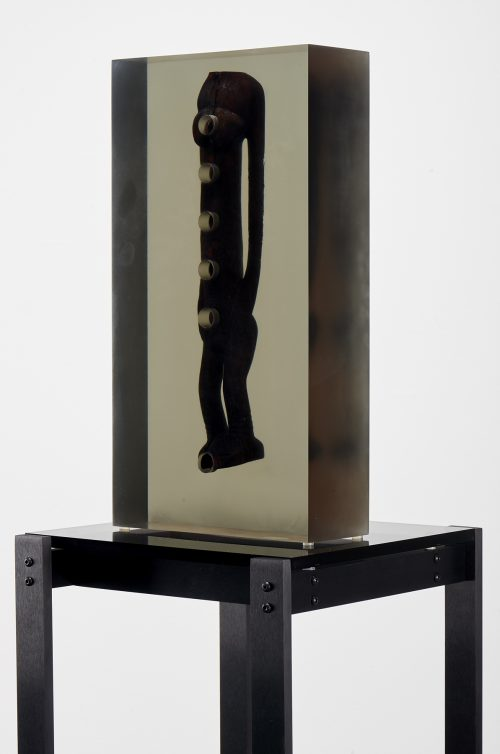 <i>Dark Silhouette: Subtle Body</i><br> Wooden sculpture from West Africa, polyurethane resin, anodized aluminum, acrylic<br> Sculpture: 18 1/4 x 9 5/8 x 3 3/4 inches / 46.2 x 24.5 x 9.6 cm<br> Overall: 66 1/4 x 13 x 13 inches / 168.28 x 33.02 x 33.02 cm<br> 2018