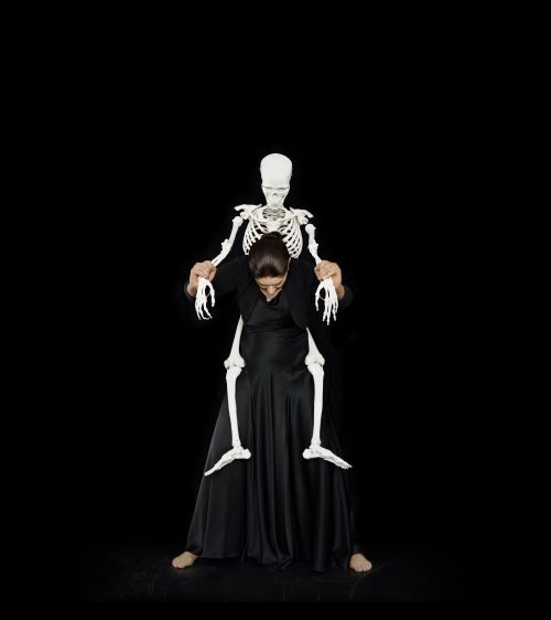 Marina Abramovic<br> <i>Standing with Skeleton,</i> 2008/2016<br> Color chromogenic print<br> Paper: 80 x 71 inches / 203.2 x 180.3 cm<br> Framed: 81 1/4 x 72 1/4 inches / 206.4 x 183.5 cm<br> Edition 4 of 9 with 2APs