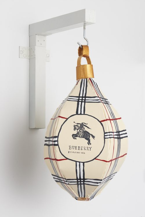 Libby Black<br> <i>Burberry Punching Bag,</i> 2007<br> Paper, hot glue, and acrylic paint<br> 9 x 9 x 15 inches / 22.9 x 22.9 x 38.1 cm