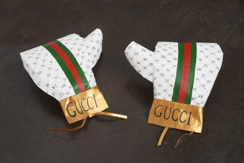 Libby Black<br> <i>Gucci Boxing Gloves,</i> 2007<br> Paper, hot glue, and acrylic paint<br> Each: 13 x 10 x 5 inches / 33 x 25.4 x 12.7 cm