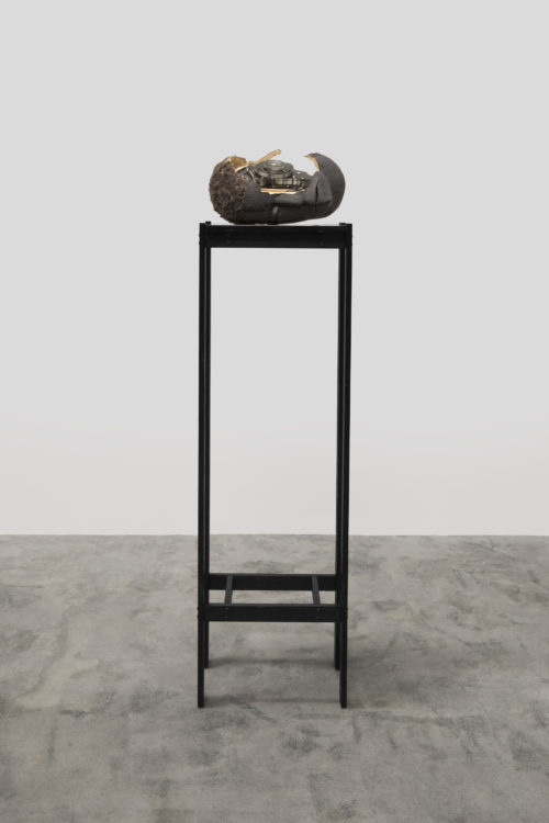 Matthew Angelo Harrison<br> <i>Dark Silhouette: Synthetic Lipiko no. 4,</i> 2018<br> Wooden sculpture, polyurethane resin, anodized aluminum, acrylic<br> 50 1/2 x 10 3/4 x 7 1/2 inches / 128.27 x 27.31 x 3.56 cm
