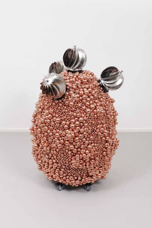 Haegue Yang<br> <i>Sonic Egg with Enthralling Tetrad – Copper Crater,</i> 2016<br> Steel stand, metal grid, powder coating, casters, copper plated bells, metal rings, turbine vents<br> 52.36 x 30.31 x 34.25 inches / 133 x 77 x 87 cm