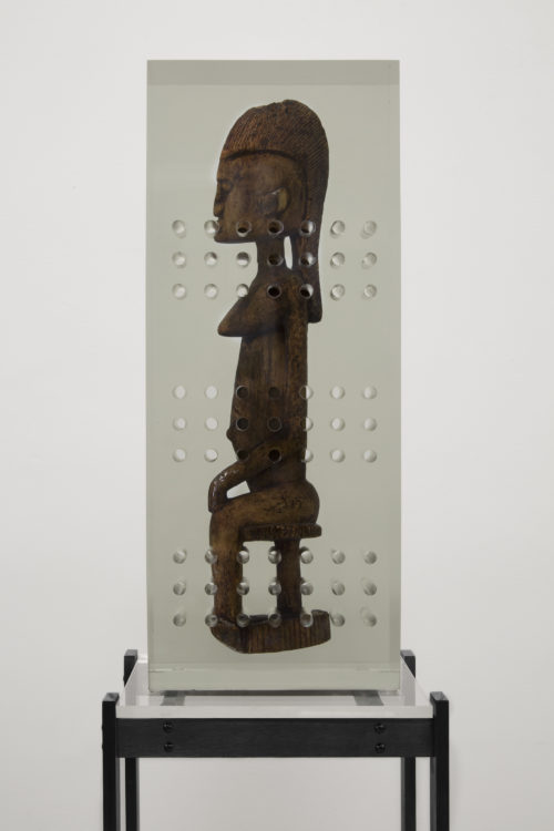 <i>Dark Silhouette: Fixtured Woman</i><br>  Wooden sculpture from West Africa, polyurethane resin, anodized aluminum, acrylic<br> 72 x 23 x 15 1/2 inches <br>2018