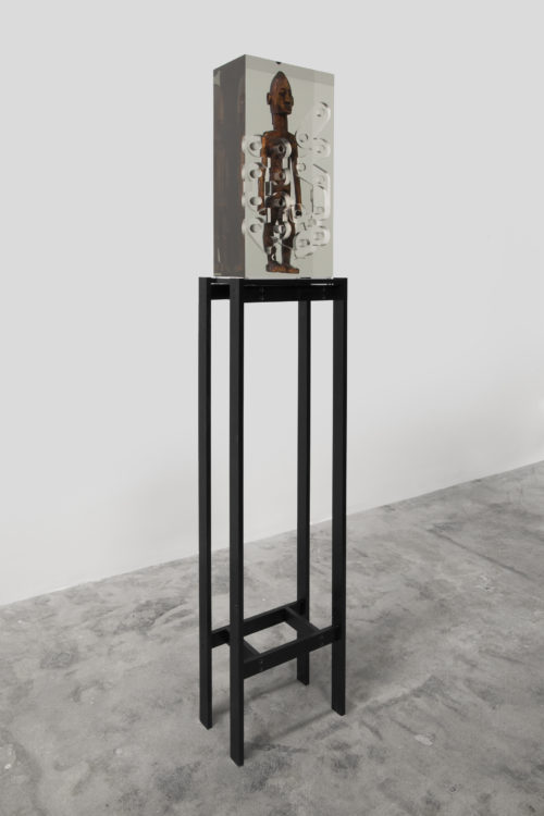 <i>Dark Silhouette: Woman Beneath Traversing Field,</i><br> Wooden sculpture from West Africa, polyurethane resin, anodized aluminum, acrylic<br> Sculpture: 20 x 9 3/4 x 5 1/2 inches / 50.8 x 24.8 x 14 cm<br> 2018