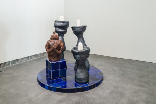 <i>Rest in power, let it not be in vain</i><br> Ceramic, glaze, custom glazed tiles, hand cast wax candles<br> 84 x 60 x 72 inches / 213.4 x 152.4 x 182.9 cm<br> 2018