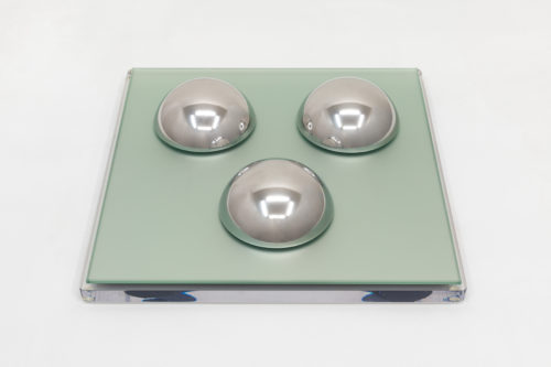 Judy Chicago <br><em>Polished Stainless Steel Domes (small)</em>, 1968 <br> Polished Stainless Steel displayed on mirrored-glass on acrylic base<br> 3 domes: 2 in. high x 5 in. diameter each