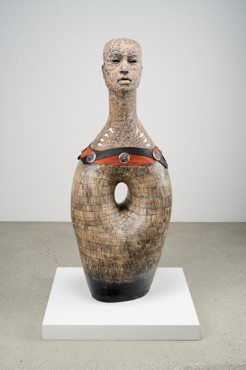 Rose B. Simpson<br><em>Reclamation III: Rite of Passage</em>, 2019<br>Ceramic, leather, steel, auto body filler, wood<br>42 1/2 x 17 x 12 inches / 108 x 43.2 x 30.5 cm