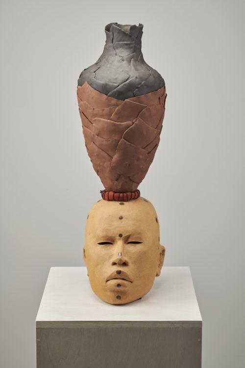Rose B. Simpson<br><em>Mother 1</em>, 2019<br>Ceramic, glaze, leather, string, and steel hardware<br>28 x 9 x 11 1/2 inches 71.1 x 22.9 x 29.2 cm