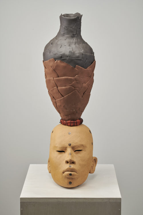Rose B. Simpson<br><em>Mother A</em>, 2019<br>Ceramic, glaze, leather, string, and steel hardware<br>28 1/2 x 10 x 11 1/2 inches 72.4 x 25.4 x 29.2 cm