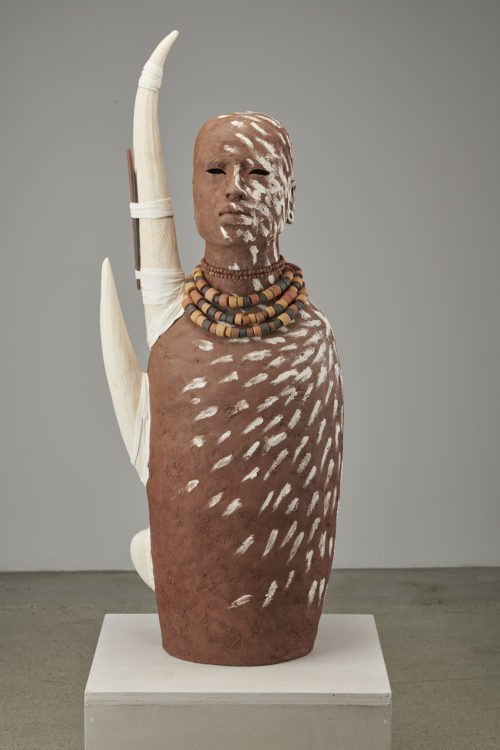 Rose B. Simpson<br><em>Tusked 1</em>, 2019<br>Ceramic, leather, and beads<br>38 1/2 x 14 x 9 1/2 inches 97.8 x 35.6 x 24.1 cm
