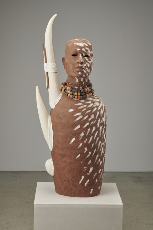 Rose B. Simpson<br><em>Tusked A</em>, 2019<br>Ceramic, leather, and beads<br>37 1/2 x 14 1/2 x 9 inches 95.3 x 36.8 x 22.9 cm