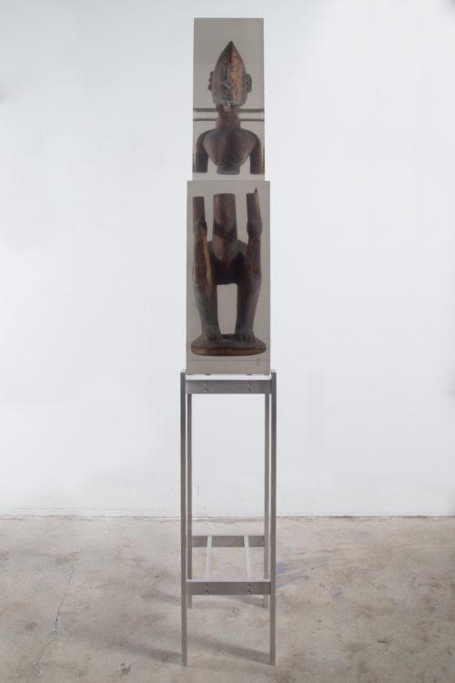 Matthew Angelo Harrison<br><em>Dark Silhouette: Balanced Sunder</em>, 2019<br>Wooden sculpture from West Africa, polyurethane resin, anodized aluminum, acrylic<br>70 1/8 x 10 1/2 x 11 inches / 178.2 x 26.7 x 28 cm